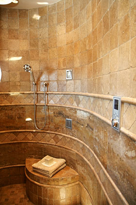 custom shower with bench and curved wall - Luxury Tile Showers