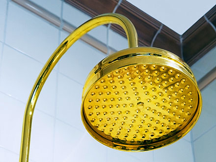 ceramic tile shower stall with brass showerhead